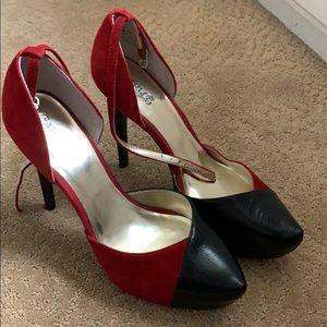 Carlos Santana black and red heels